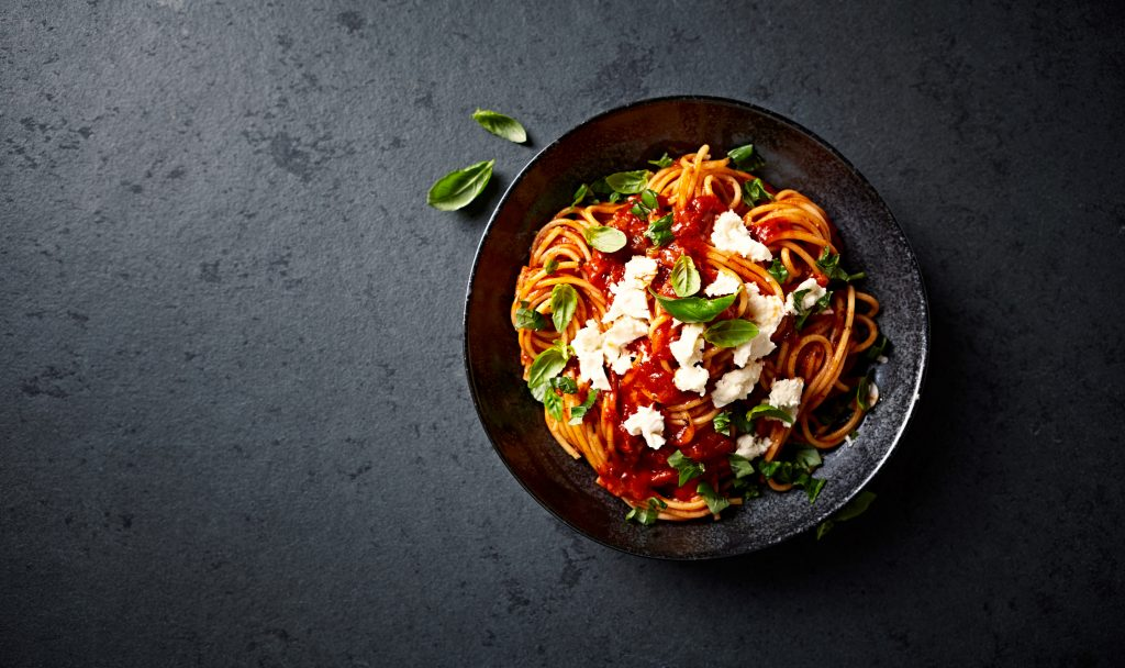 Spaghetti with fresh Tomato Sauce, Mozzarella and Basil ( seen from above)